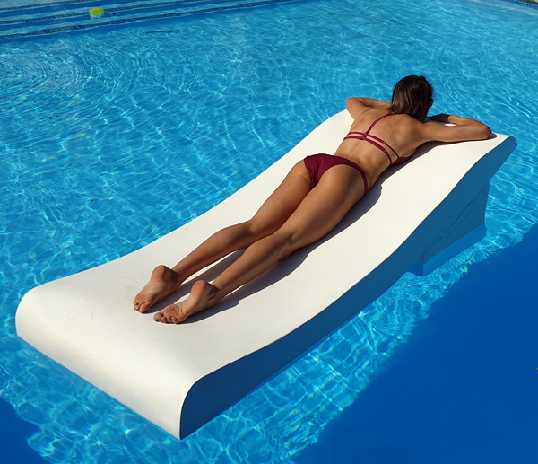duo tanning chair on swimming pool lying on stomach
